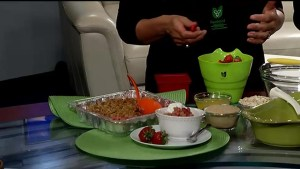 Food specialist Korey Kealey serves up strawberry and rhubarb crumble