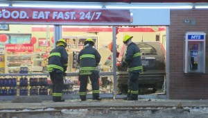 RAW: Crews work to free SUV after plowing into 7-Eleven