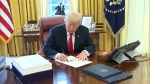 Trump signs $1.5 trillion tax overhaul before heading for holidays
