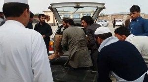 Emergency officials treat wounded in Afghanistan after explosion at mosque