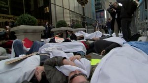 Demonstrators stage 'die-in' to protest against Trump's shooting comment