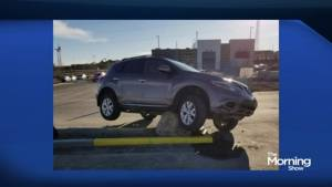 How did this car flip over in a Calgary mall parking lot?