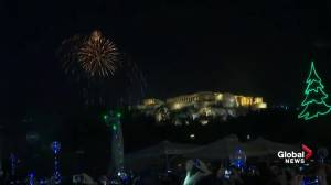 Fireworks light up sky above Greece's Acropolis celebrating New Year's