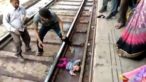 Footage shows 'miracle baby' emerge unscathed after run over by train
