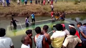 Children among at least 25 killed after bus crashes into river in India