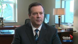 Jason Kenney prepares to take his seat in the Alberta legislature