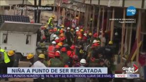 Mexican rescuer workers rush to find students trapped in collapsed school