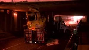 Excavator gets stuck under Montreal overpass