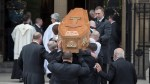 Lyra McKee funeral: Mourners applaud as murdered journalist's casket carried into church