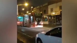 'Reckless' man seen hanging onto back of Melbourne tram while singing