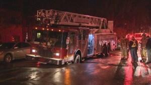 RAW: Firetruck stuck in sinkhole