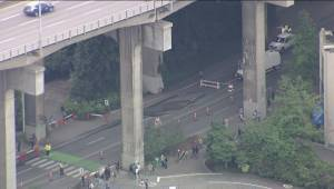 Sinkhole at the entrance to Granville Island snarls traffic