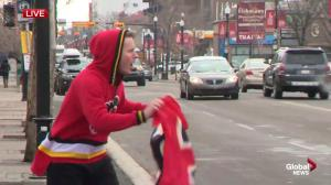 Matthew Conrod runs down the Red Mile in a Flames onesie