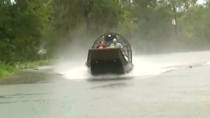 Houston residents wade through waist high water after Harvey