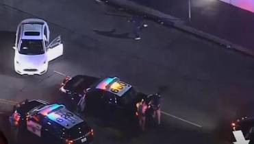 Bumped by police and spun out, L A  driver busts a move