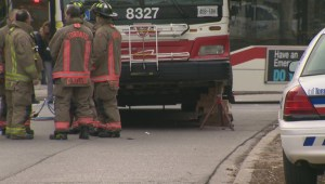 Firefighters save woman trapped under TTC bus