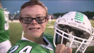 High school football team lets water boy with special needs score touchdown to surprise terminally ill mom