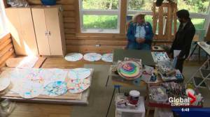 Who is Alex Janvier, the artist behind the tile mosaic artwork at Rogers Place?