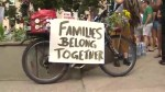 Families Belong Together protests across street from U.S. consulate in Toronto