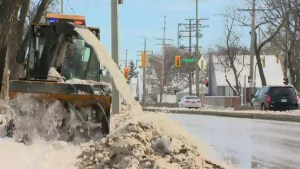 Winnipeg pedestrians climb sidewalk 'mountains' as city continues cleanup
