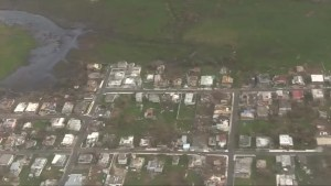 U.S. airmen survey post-hurricane damage over northern Puerto Rico