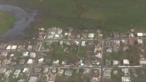 U.S. airmen survey post-hurricane damage over northern Puerto Rico