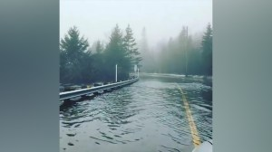 Drivers navigate flooded roads in Quebec along Rivière du Nord
