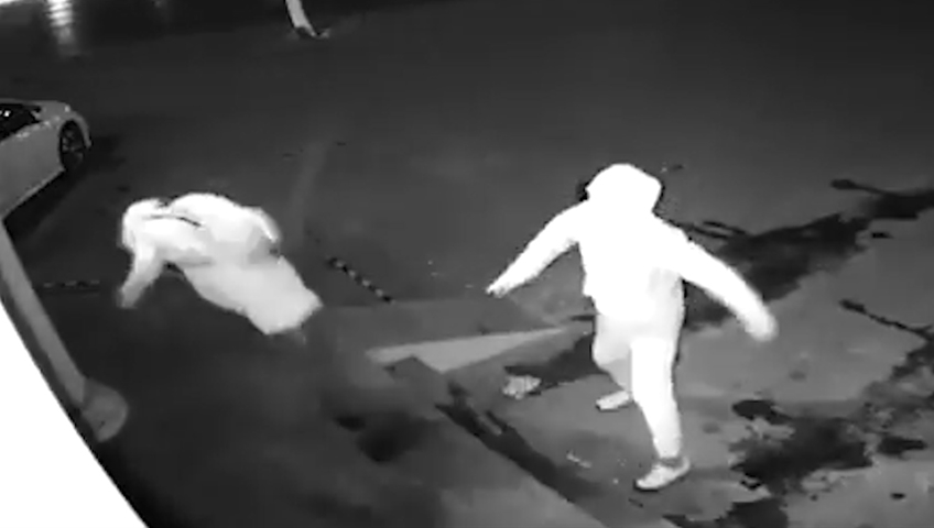Watch this bungling burglar lob a brick straight at his partner's head