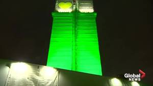 Grenfell Tower turns green to commemorate fire victims