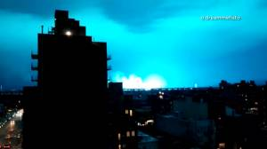 Transformer explosion in New York creates eerie blue light in sky prompting alien jokes and theories