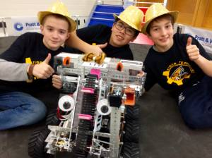 Grade 6 and 7 students show off their new robot