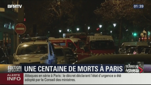 Gunfire rings out around Bataclan concert hall in Paris as police confront hostage-takers