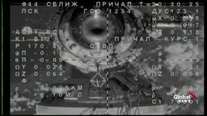 Manned Soyuz spacecraft docks with ISS