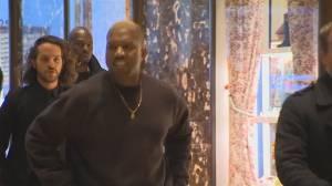 Kanye West arrives at Trump Tower