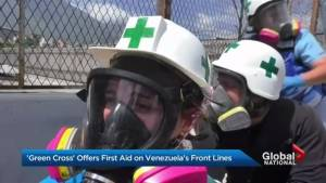 'Green helmets' come to the rescue of Venezuela protesters