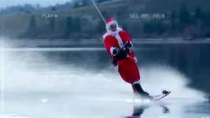 Santa suit wearing water skier takes a spin around Okanagan Lake