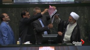 Iranian politicians set fire to US flag in parliament