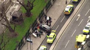 Police, paramedics surround car after 'firearms incident' outside UK parliament
