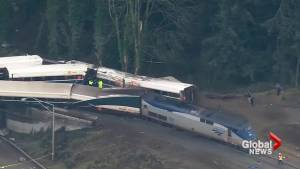 Investigators looking at possibility someone distracted engineer in deadly Amtrak derailment