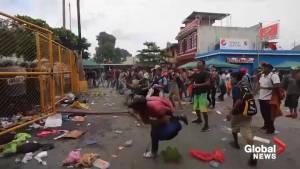 Second migrant caravan smashes through Mexico border as clashes erupt