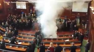 Opposition lawmakers disrupt Kosovo parliament session with tear gas