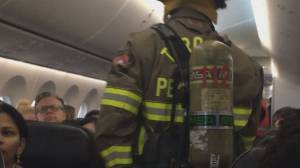 Inside Air Canada flight delayed after smartphone catches fire