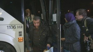 Sleep at last: refugees arrive at their hotel after long journey to Canada
