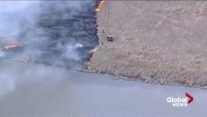 Fire crews battle grass fire north of Edmonton