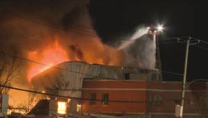 Five-alarm fire burns industrial building in Anjou