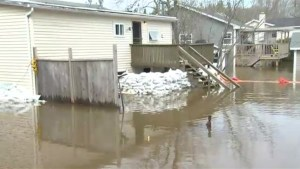 Rising flood waters in New Brunswick continue to raise health and safety concerns