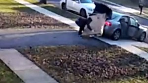 Alleged Maryland thief caught on camera tripping over TV, seen unable to fit it in car