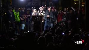 Celebrities come together to sing a song during anti-Donald Trump rally