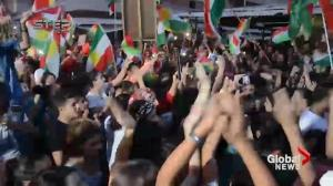 Residents of Kurdish town in Syria celebrate referendum in Iraq
