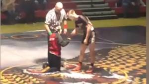 Crowd erupts as teen with cerebral palsy pins opponent at high school wrestling meet